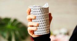 Folding disposable coffee cup eliminates plastic lids